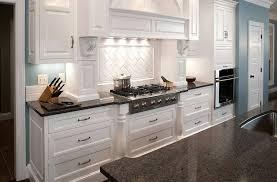 fascinating white illuminated kitchen cabinet with quartz countertop