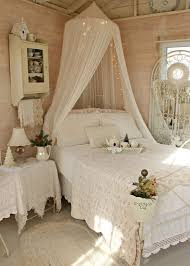 sweet shabby chic bedroom with a canopy bed