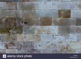 painted stone wallTexture of an old multicolored painted stone wall with mold dents