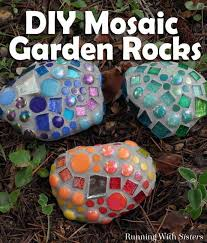 make mosaic garden rocks to add a pop of color to the garden we