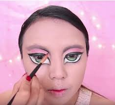 tamang topped her face with concealer popped on her eye shadow primer and then began creating that signature bratz doll eye