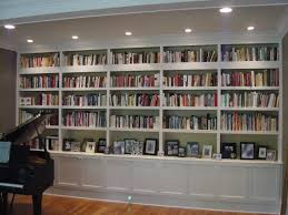 office bookshelves designs. Astonishing Modern Living Room Bookcases Along With White Paint Also Cool Ceiling Lightings For Reading Office Bookshelves Designs