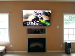 pull down tv mount above fireplace for aeon 50300 wall over uk the