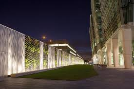 green wall lighting. white led fixtures from philips color kinetics add a movement to the green wall at birmingham lighting g