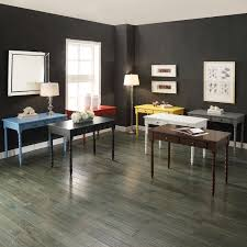 The dark walls could be nice with warm light and whitewashed wood to  compliment. Also bright furniture.