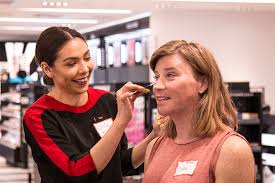 sephora makeup cles an image of a sephora employee applying makeup on a trans