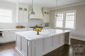 white kitchen with grey island