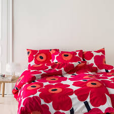 marimekko unikko duevet cover and pillow case with a red white florar print