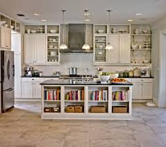 white kitchen storage cabinet with chandelier and glass door and tile flooring