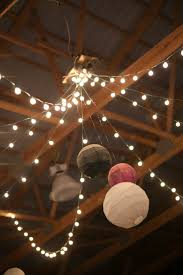 lights cascading out from centre of room and lanterns falling down from  centre