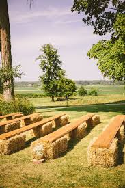 Bales of hay for ceremony guests to sit on. maybe with blankets over them.