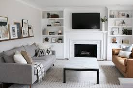 white and gray family room with a marble coffee table