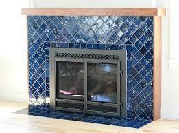 blue handmade tile around fireplace