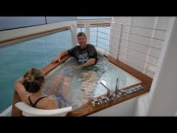 an affordable cruise ship suite with a private jacuzzi