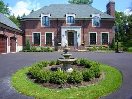 Circle driveway with Boxwood hedge around water fountain in West Bloomfield  Michigan. All Natural Landscapes