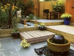 wooden decking ideas for small garden with small round table and chairs