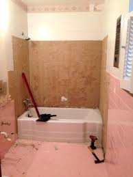 how to remove tile from bathroom wall q how do i remove the adhesive from s how to remove tile from bathroom wall