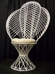 white wicker fanback chair w cushion