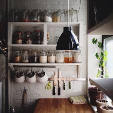creative diy wood wall mounted kitchen shelving units with hooks painted with white color for narrow kitchen spaces with hanging lamp for ceiling ideas