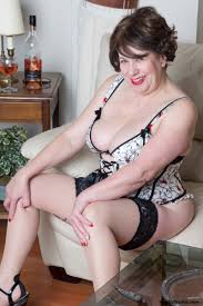 A mature woman in lingerie posing on the couch from Trisha