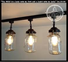 mason jar lighting fixtures a mason jar track light of 3 vintage quarts the lamp goods mason jar lighting