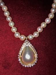 antique teardrop pearl pendant with white diamonds on pearl necklace