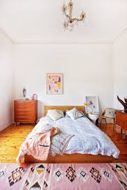 this bedroom is a good example of how a rug can give color and warmth to a room imagine this space without the kilim style rug and it a bit cold and