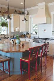 the kitchen remains coastal with its light airy feel while accents such as subway