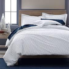 spencer stripe flannel duvet sham designed with a handsome blue pinstripe on a white