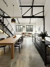 concrete flooring and natural tones create a minimalist neutral aesthetic in this warehouse loft