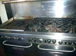 glass stove top with baking soda and vinegar clean