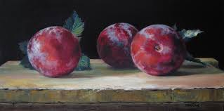 three plums on cutting board sold