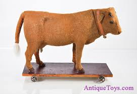 rare antique mooing german felt covered cow on wooden platform pull toy