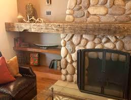 reclaimed wood beam living room farmhouse with stone fireplace surround palo alto urban farmhouse stone hearth
