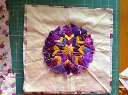 Folded star pot holder | Sewn Up & Now take the 10 1/2 in square and make a circle smaller than the filed star. Adamdwight.com