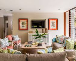 Inspiration for a beach style family room remodel in Brisbane with beige  walls and a wall