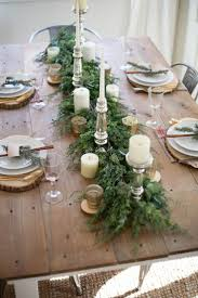A beautiful farmhouse Christmas tablescape with rustic elements, mixed  metals, and natural greenery.