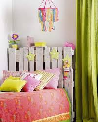 even a kid s bed could look awesome with a diy pallet headboard just some cute