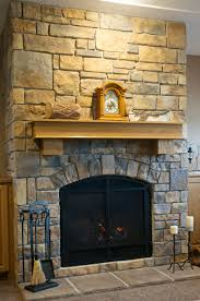 stone fireplace with irregular surfaces how to hang art