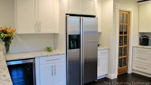 Modern Kitchen With White Simple Panel Kitchen Cabinets Long