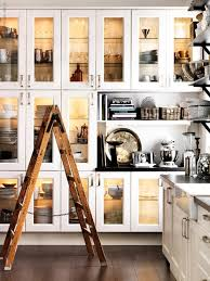 huge kitchen design with lots of storage white glass front kitchen cabinets farmhouse sink black countertops and black industrial shelves
