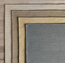 solid braided outdoor rug in wheat sunbrella rugs