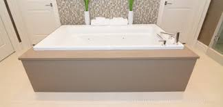 surround your bathtub with beautiful stone