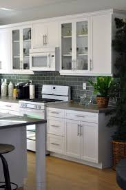 how to make shaker cabinet doors. Charming Grey Ceramic Subway Backsplash Also White Shaker Kitchen Cabinets Ideas As Well Small Island And Round Stools In Space How To Make Cabinet Doors R