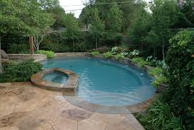 swimming pool stunning backyard pool landscaping with neutral green plant garden and beige rock pool