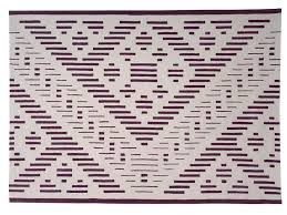 handmade rectangular wool rug with geometric shapes hyper by dare to rug