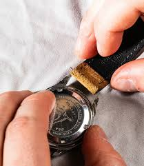 once one side of the spring bar is free from the case sometimes you can simply grab it and slide it out of the other side of the watch especially with