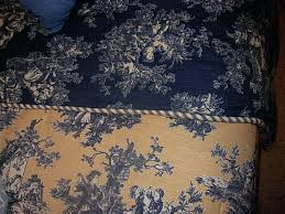blue and brown toile bedding