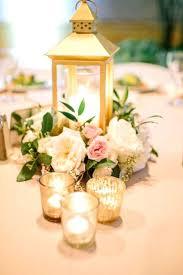 wooden lantern centerpieces a candle lantern centerpiece with blush and creamy flowers wooden lanterns wedding centerpieces