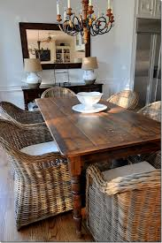 i have always loved deep fortable wicker chairs paired with a big ol rustic farm table